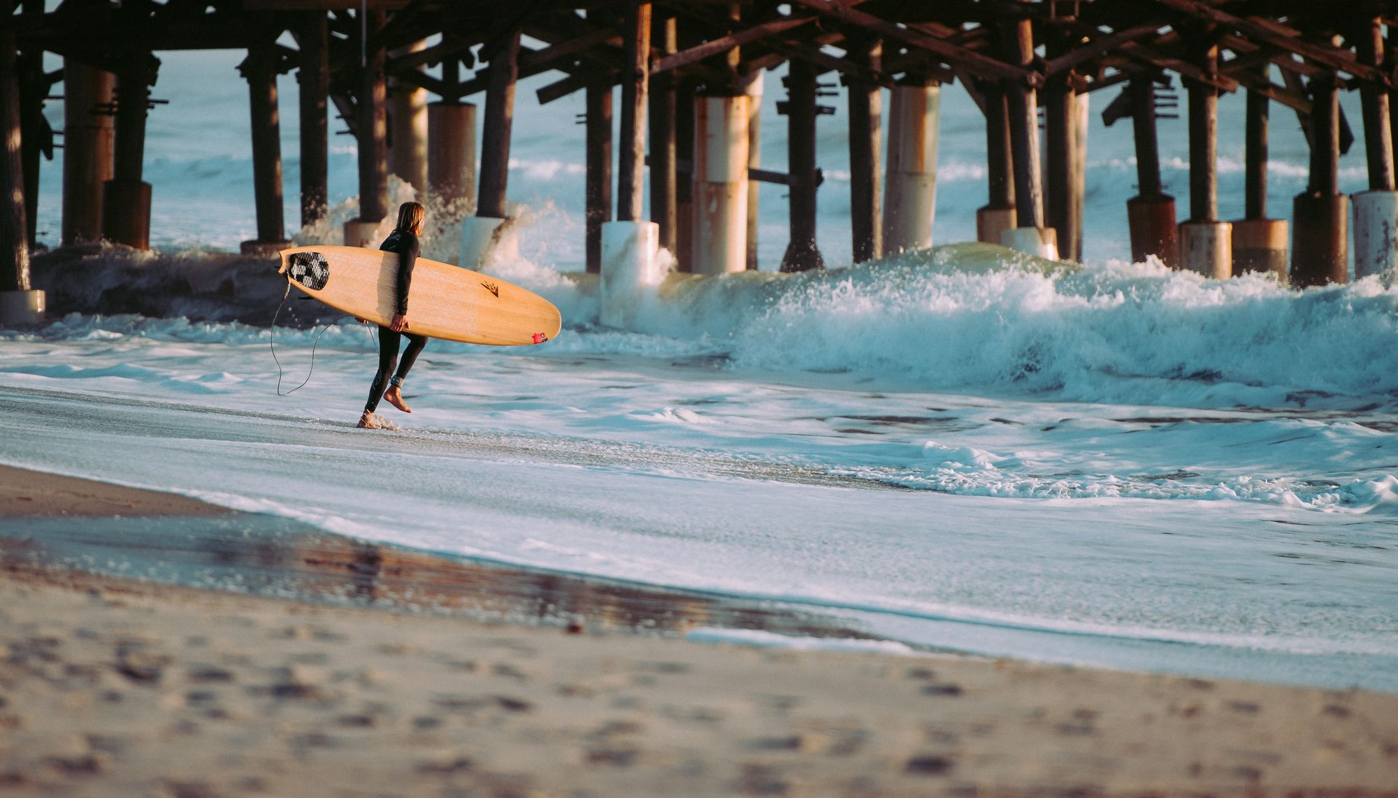 Hitting the waves surfer