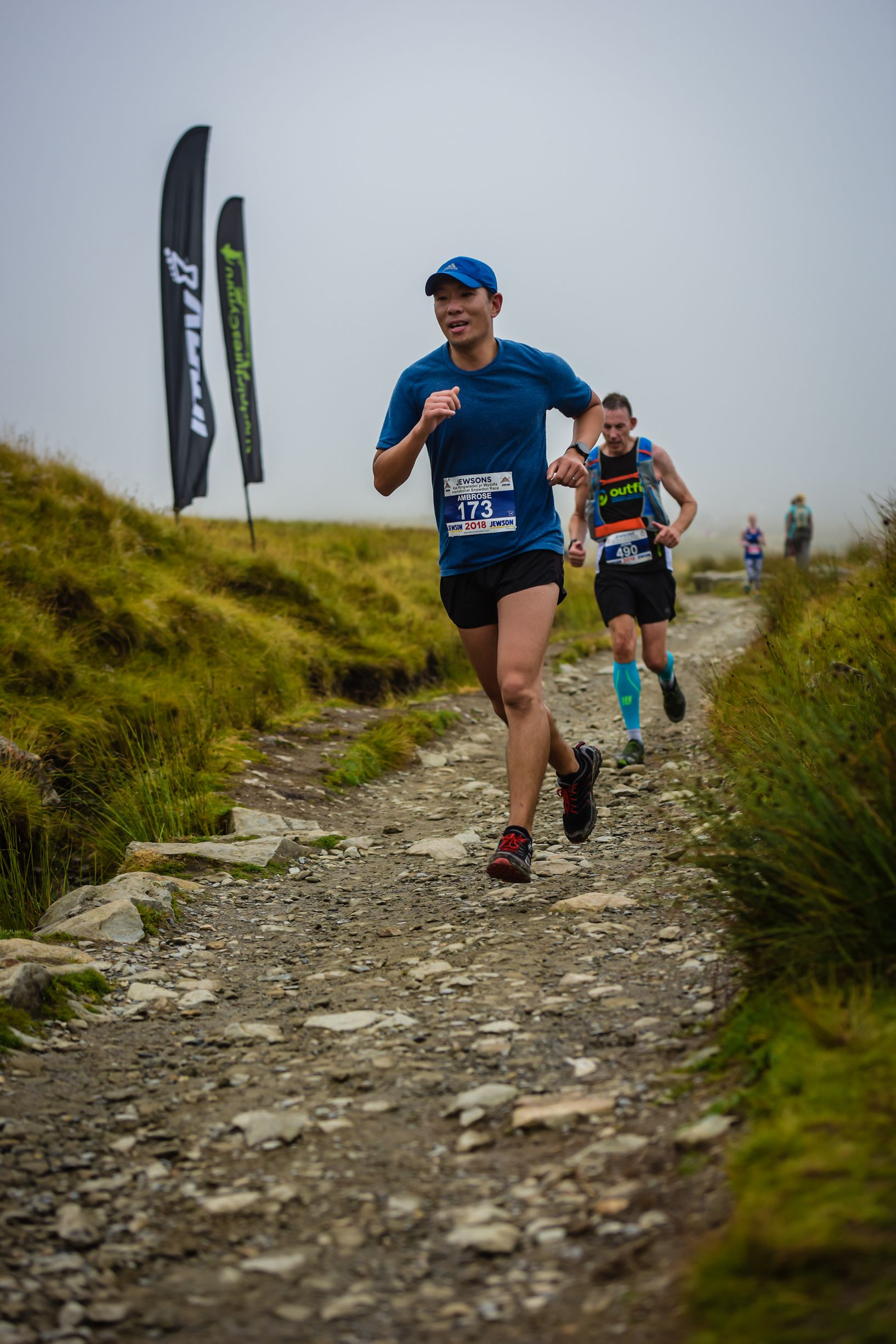 Teem Up founder participating in a running competition outdoors on a dirt trail