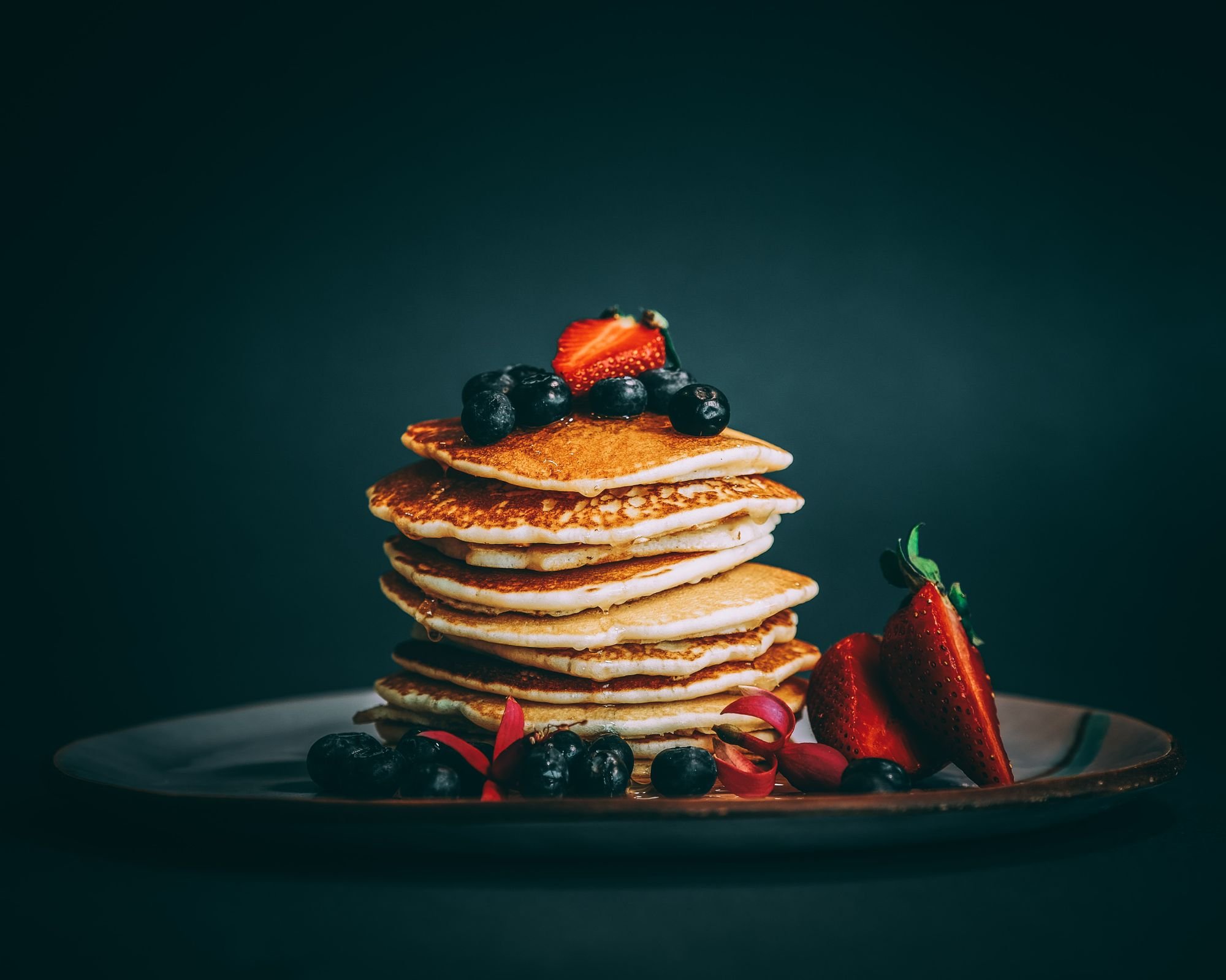 Pancakes with blueberries and strawberries
