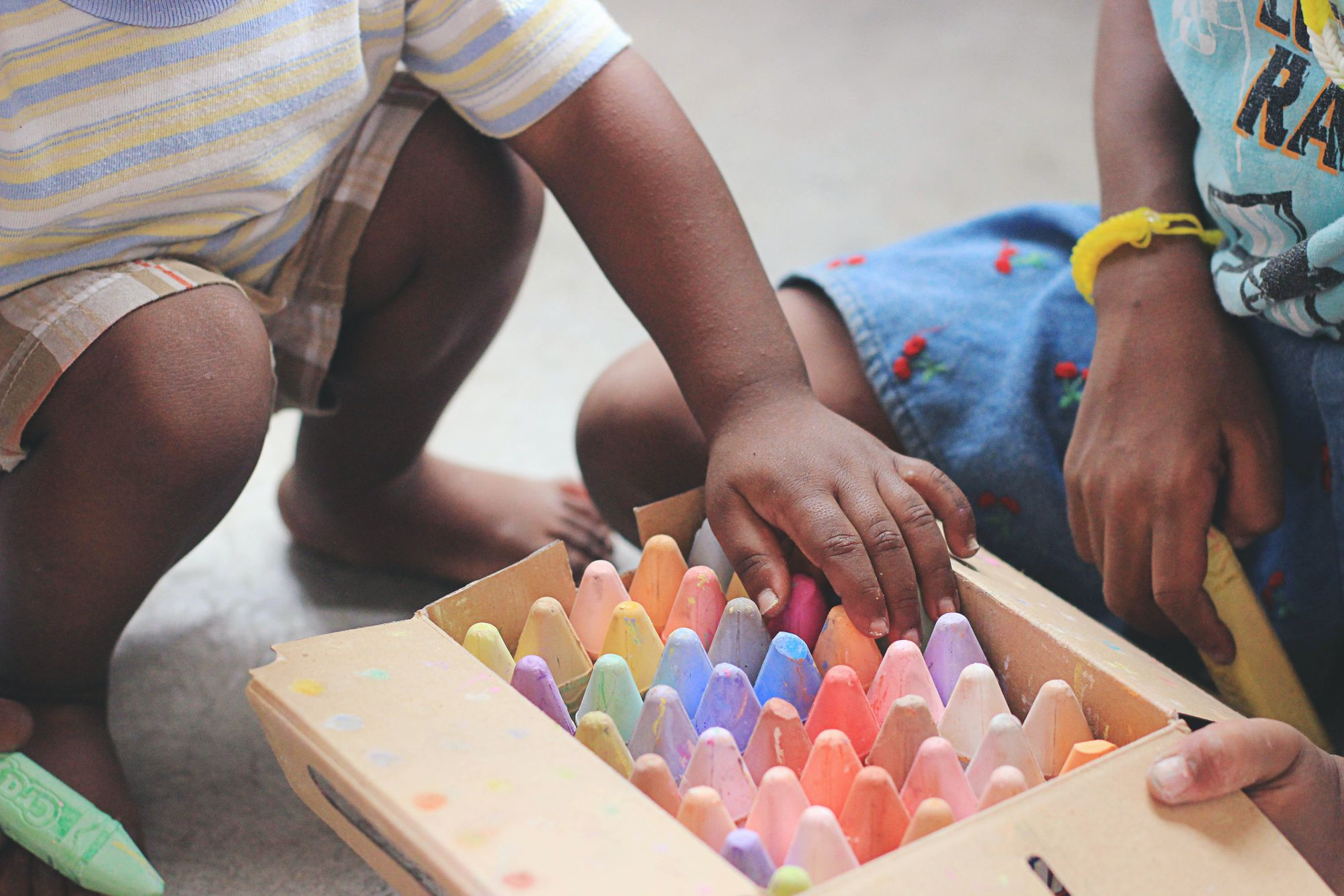 Children playing with coloring pencils